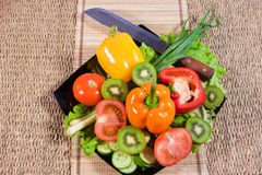 Varicoloured fruit and vegetables Stock Images