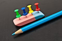 The Varicoloured office button,lasting and pencil. Royalty Free Stock Photos