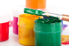 Varicoloured paints and brushes Stock Image