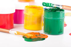 Varicoloured paints and brushes Royalty Free Stock Photography