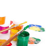 Varicoloured paints and brushes, school Stock Photo