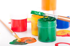 Varicoloured paints and brushes on a white Stock Photo
