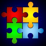 Varicoloured puzzle on a blue background Royalty Free Stock Image
