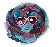 Varicoloured scarf is put around with spectacles Royalty Free Stock Photo