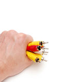 Varicoloured Seilzug in einer Hand Stockbild
