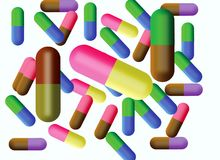 Varicoloured tablets in capsule Stock Image