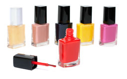Varicoloured varnish for nail, open red vial Royalty Free Stock Photos