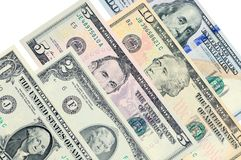Varie banconote della bugia una dei dollari americani su un altro Fotografie Stock Libere da Diritti