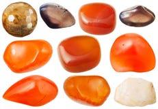 Varie gemme di cornalina e del chalcedony Fotografie Stock
