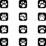Varie impronte, segni, zampe, zampe, etichette dell'autoadesivo, bottoni, raccolta delle icone royalty illustrazione gratis