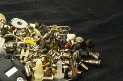 varie viti, bulloni, rondelle, dadi ed altri fermi del computer piccoli Fotografia Stock