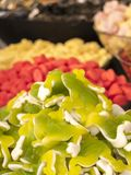 Varied candy heaps. In the foreground fruit gum gummy candies, g Royalty Free Stock Images