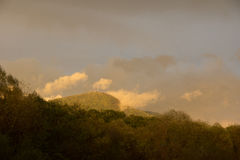 Varied in colour clouds above mountains. Stock Photography