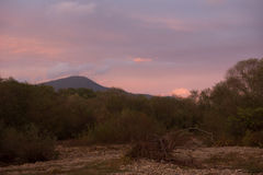Varied in colour clouds above mountains. Royalty Free Stock Photography