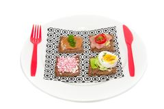 Varied fillings on slices bread Stock Image