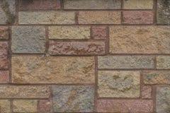 Varied fizeram sob medida e a textura do fundo do tijolo da cor Fotografia de Stock Royalty Free