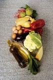 Varied food vegetables, oil eggs meat .... Stock Images