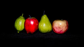 Varied Fruits. On black fabric stock image