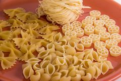 Varied macaroni on a plate macro royalty free stock image