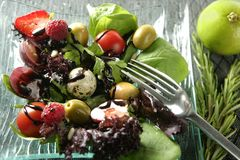 Varied salad with fruits and vegetables. Original contemporary kitchen stock photos