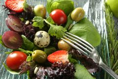 Varied salad with fruits and vegetables Stock Photo