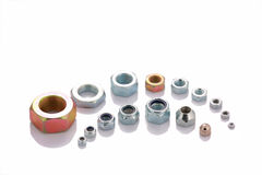 Varied steel nuts isolated with copyspace Stock Images