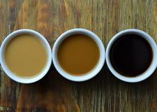 Variedad de café en el fondo de madera Imágenes de archivo libres de regalías