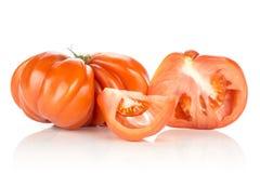 Variedade crua fresca do tomate da carne do tomate isolada no branco Fotos de Stock Royalty Free