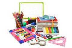 Variedade da escola e dos materiais de escritório isolados no backg branco Imagem de Stock