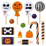 Variedade de doces coloridos de Dia das Bruxas ilustração stock