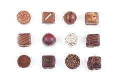 Variedade de doces e de confeitos de chocolate Fotografia de Stock Royalty Free