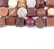 Variedade de doces e de confeitos de chocolate Imagem de Stock
