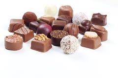 Variedade de doces e de confeitos de chocolate Fotos de Stock
