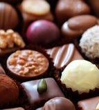 Variedade de doces e de confeitos de chocolate Imagens de Stock Royalty Free