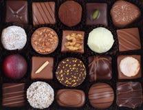 Variedade de doces e de confeitos de chocolate Fotografia de Stock