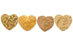 Variedade de mostarda no chape do coração fotos de stock