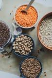 Variedade de sementes do feijão em uma bacia No fundo rústico Fotografia de Stock Royalty Free