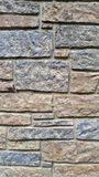 Variegated brick wall texture. Brick wall of various sized bricks, with different shades of gray and red for textured background Stock Photo
