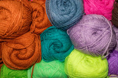 Variegated colored wool. Many woolen yarn variegated colors stock photography