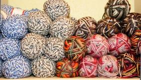 Variegated yarn skeins on display Stock Photos
