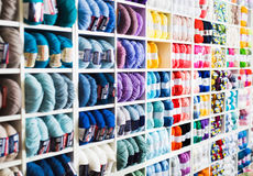 Variegated yarns for knitting on shop shelf Royalty Free Stock Photo