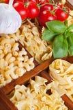 Varietà della pasta con condimento specifico Fotografia Stock Libera da Diritti