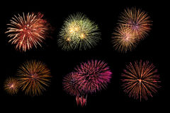 Varietà di fuochi d'artificio variopinti isolati su fondo nero Immagini Stock Libere da Diritti