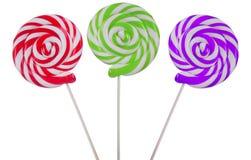 Varietà di lollipops su bianco Immagine Stock