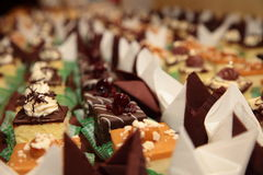 Varieties of cakes desserts catering sweets Stock Photography