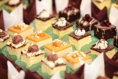 Varieties of cakes desserts catering sweets Royalty Free Stock Images