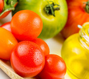 Varieties of colorful tomatos and olive oil Royalty Free Stock Image
