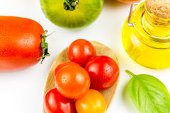 Varieties of colorful tomatos and olive oil Royalty Free Stock Photos