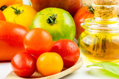 Varieties of colorful tomatos and olive oil Stock Image