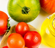 Varieties of colorful tomatos and olive oil Royalty Free Stock Photo